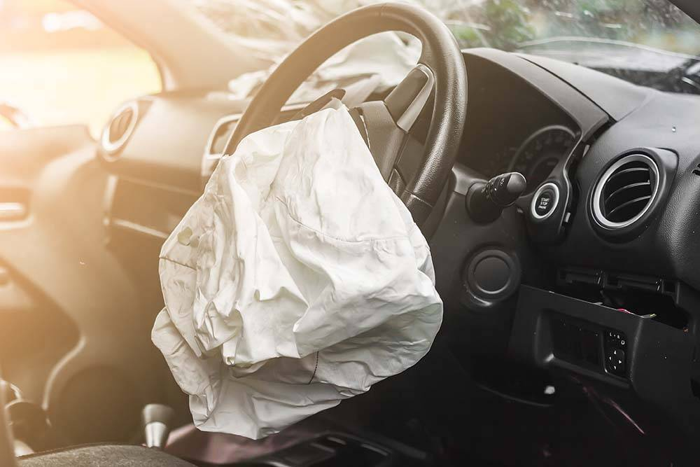 broken air bag in car